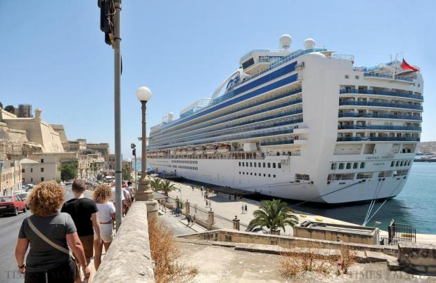 Tourists walk towards the cruise liner Emerald Princess in the Grand Harbour in Valletta on July 1. Photo: Chris Sant Fournier