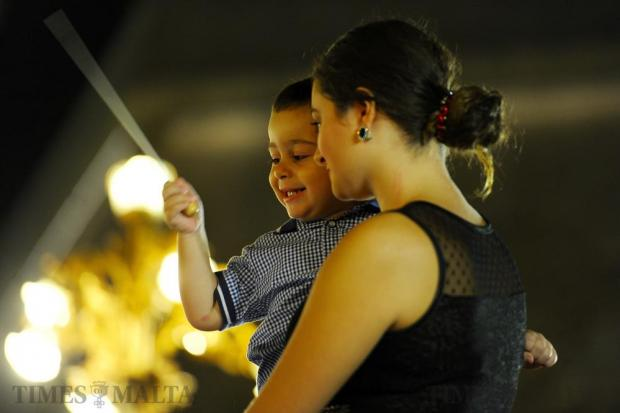 A mother enjoys a session of music with her son during Notte Bianca in Valletta on October 1. Photo: Steve Zammit Lupi