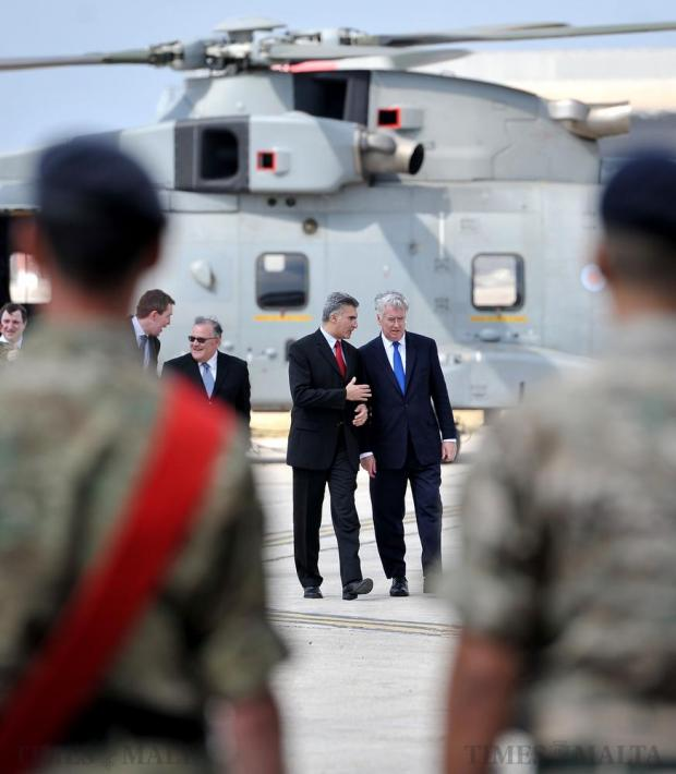 Interior Minister Carmelo Abela welcomes UK Defence Secretary Michael Fallon (centre right) to the AFM Airwing base at Malta International Airport on June 6. Photo: Chris Sant Fournier