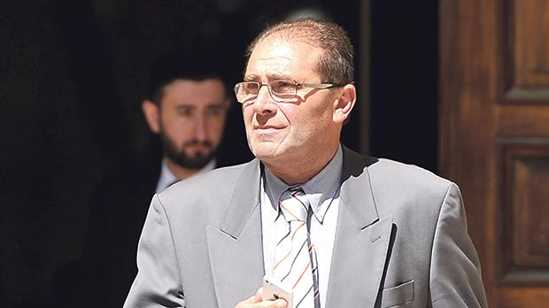 Edward Caruana, in court yesterday to face corruption and bribery charges.