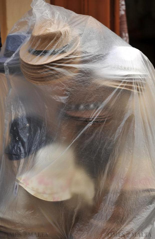 Hats are covered from the rain by a plastic sheet in Valletta on November 16. Photo: Chris Sant Fournier