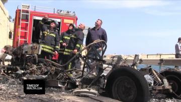 Watch: Blazing city cab chokes Valletta in black smoke