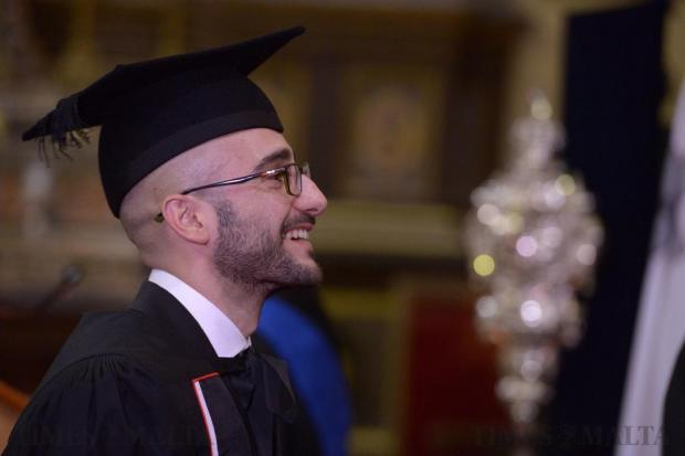 A student prepares to be presented with his graduation certificate at the Jesuit Church in Valletta on November 25. Photo: Matthew Mirabelli