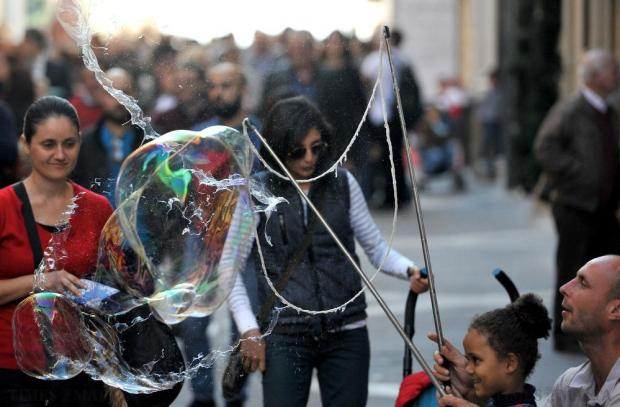 A soap bubble produced by a girl bursts in Republic Street in Valletta on December 23. Photo: Chris Sant Fournier