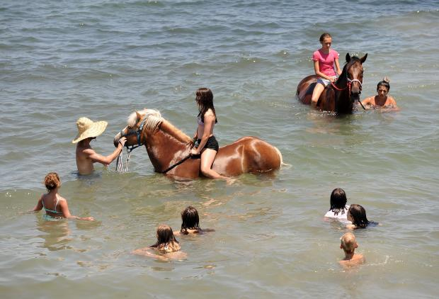Children ride horses in the sea at Bahar Ic-Caghaq on July 17. Photo: Chris Sant Fournier