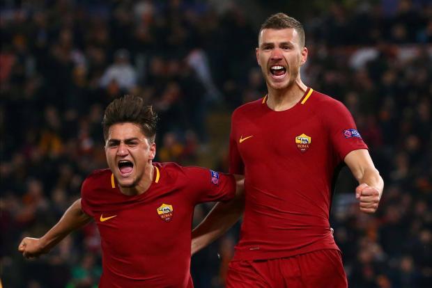 Edin Dzeko (right) celebrates his winner for Roma against Shakhtar Donetsk.
