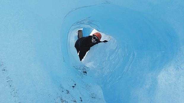 The author peering through a typical ice formation on the Perito Moreno Glacier in Argentina. Photo: Silvan Chetcuti
