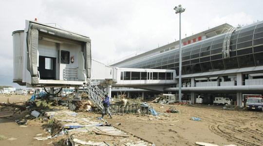Debris is scattered around the terminal building at Sendai Airport in Natori, outside of Sendai in Miyagi prefecture. Dealers said some market players appeared to be buying the yen on expectations that Japanese companies will repatriate funds to pay for reconstruction. Photo: AFP