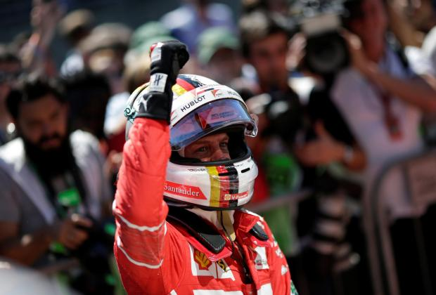 Ferrari's Sebastian Vettel celebrates winning the race.