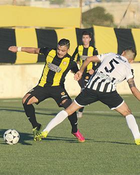 Xewkija Tigers forward Thiago Dos Santos (left) sweeps past Għajnsielem's Jairo Sandoval Guarin. Photo: AnthonyCassar