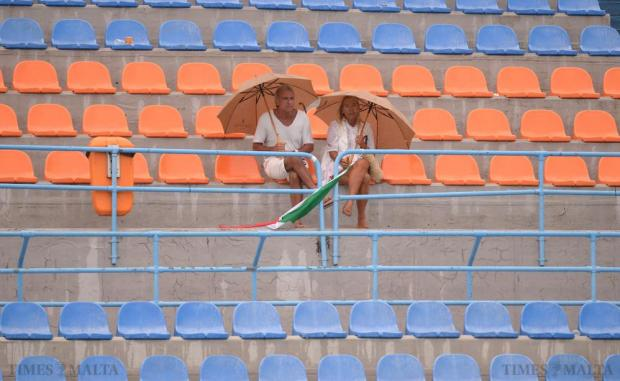 Spectators brave the rain to watch a waterpolo U-20 Comen Cup match between Italy and Serbia at the National Pool in Tal'Qroqq on August 16. Photo: Matthew Mirabelli