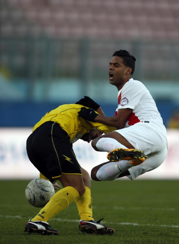 Valletta's Abdelkarim Nafti (right) is fouled by an Qormi player during their Premier League football match at the National Stadium in Ta' Qali on January 3. Photo: Darrin Zammit Lupi