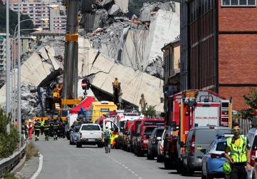 Genoa bridge collapse: rescuers battle fire as they search for missing people