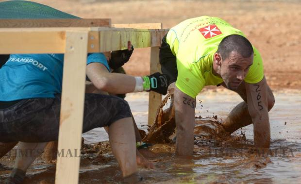 A participant makes his way through the mud whilst taking part in The Grid obstacle course race in Pembroke on May 29. The race, the first of its kind in Malta, covered 15km and included over 30 obstacles. Photo: Matthew Mirabelli