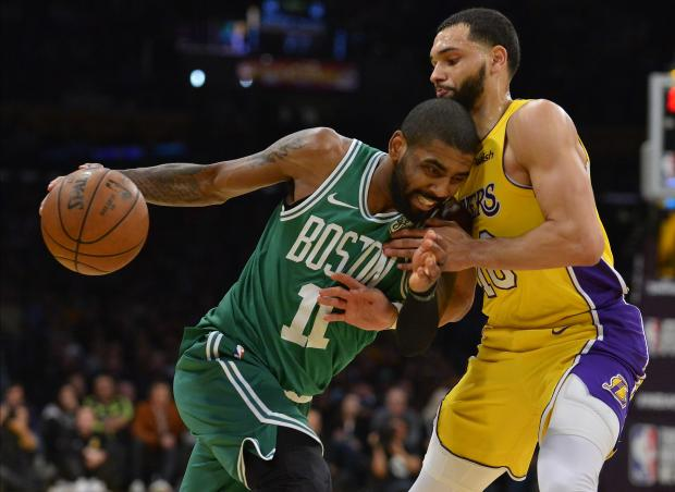 Boston Celtics guard Kyrie Irving (11) moves the ball against Los Angeles Lakers guard Tyler Ennis (10) during the second half at Staples Center. Photo: Gary A. Vasquez-USA TODAY Sports