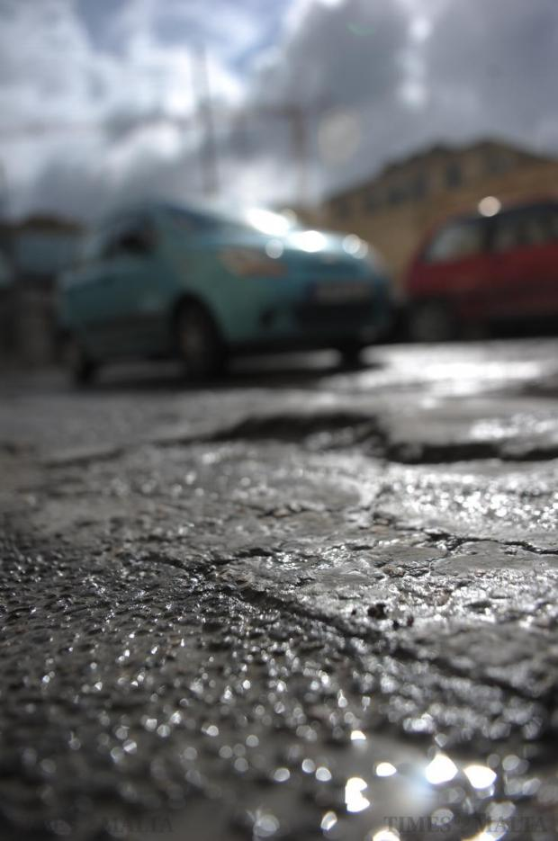 A potholed and uneven road surface is seen on January 24 following several days of heavy rainfall. Photo: Jason Borg