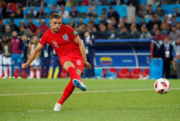 Jordan Henderson takes his penalty against Colombia on Tuesday.