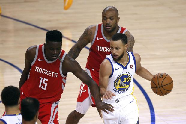 Golden State Warriors guard Stephen Curry (30) drives to the basket against Houston Rockets center Clint Capela (15) during the first quarter in game six of the Western conference finals of the 2018 NBA Playoffs at Oracle Arena. Photo Credit: Cary Edmondson-USA TODAY Sports