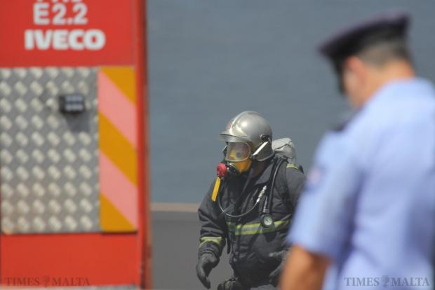 A fire fighter walks back to a fire engine after fighting a fire that broke out in the stores of the Radisson Blu Hotel in St Julian's on June 16. Photo: Paul Spiteri Lucas