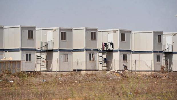 Portakabins used for housing for refugees at the Hal Far Open Centre are seen on August 17. Photo: Chris Sant Fournier
