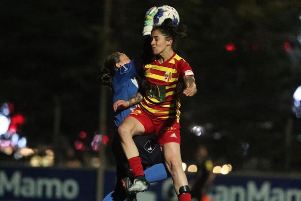 Mġarr United's goalkeeper Rachel Borg reaches for the ball over Ylenia Carabott of Birkirkara. Photo: Domenic Aquilina/MFA