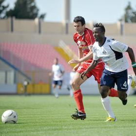 Sliema's Stanley Ohawuchi (right) speeds past Branislav Timotic, of Tarxien. Photo: Chris Sant Fournier