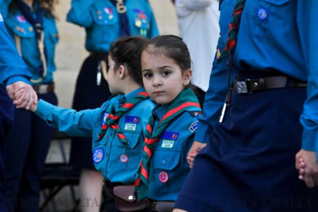 A young girl guide looks on as she marches through St George's Square during the Annual Scout parade in Valletta on April 17. Photo: Steve Zammit Lupi