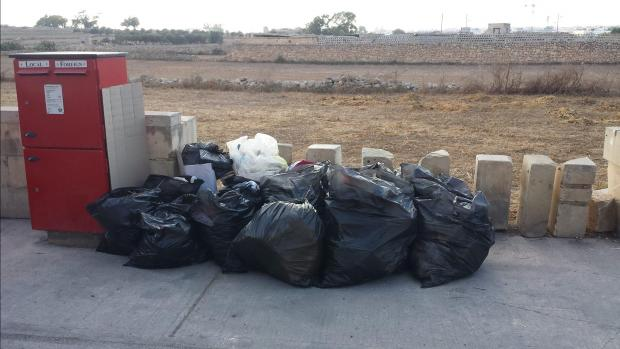The 16 bags of rubbish were collected from a field.