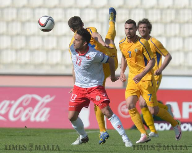 Malta's Andre Schembri wins a challenge during an International friendly against Moldova at the National Stadium in Ta'Qali on March 24. Photo: Matthew Mirabelli
