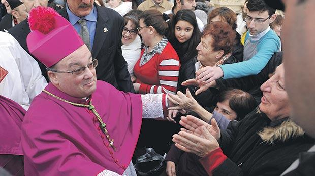 Mgr Scicluna greets his flock on the day of his official investiture. Photo: Chris Sant Fournier
