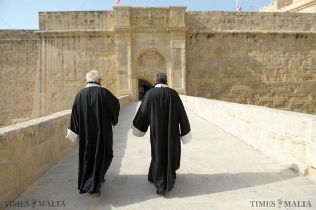 Two members of the Order of the Knights of St John make their way to the start of a ceremony held at St Lawrence church in Vittoriosa. The religious ceremony held on September 6 marked the anniversary of the Great siege. Photo: Matthew Mirabelli
