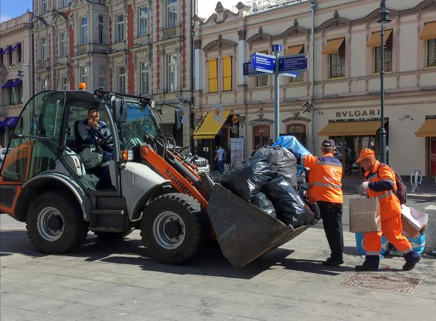 Workers get to work cleaning up Moscow. Photo: Reuters
