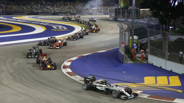 Driver, marshal survive close calls at Singapore GP