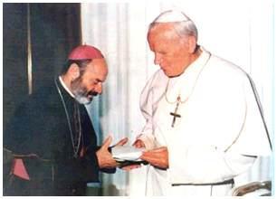 Bishop Micallef is seen here with Pope John Paul II. Photo: avona.org