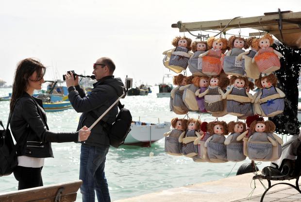 Tourists take photos at the Marsaxlokk market on March 7. Photo: Chris Sant Fournier