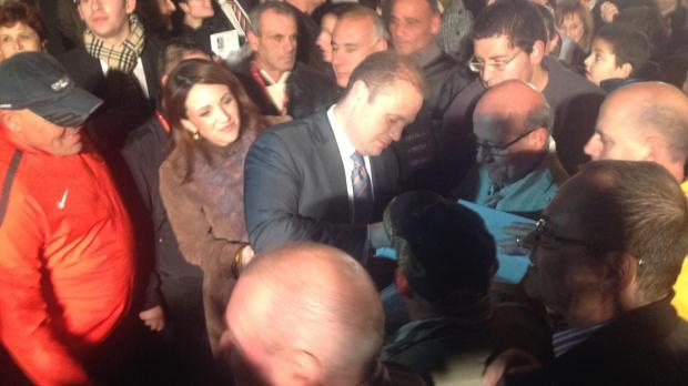 Joseph Muscat signs a biography by Cyrus Engerer at the end of a speech in Lija.