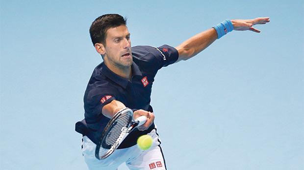 Novak Djokovic returns a shot against David Goffin, yesterday.