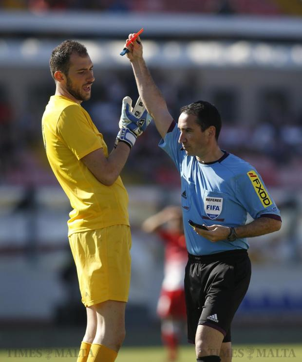Valletta's goalkeeper Pietro Marino reacts as referee Clayton Pisani shows him a straight red card after fouling Hibernians' Jorginho during the final Premier League football match of the season at the National Stadium in Ta' Qali on May 9. Photo: Darrin Zammit Lupi