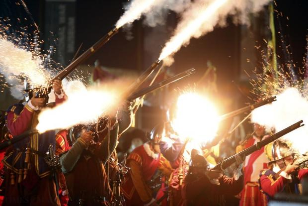 Re-enactors fire their muskets during an In Guardia historical re-enactment of the inspection of Fort St. Elmo during Notte Bianca (White Night) celebrations in Valletta on October 3. Photo: Darrin Zammit Lupi