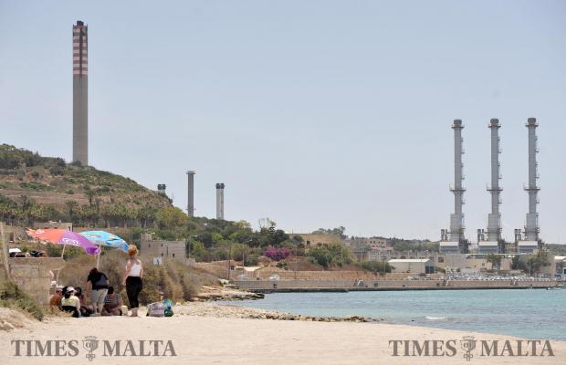 A family sets up umbrellas on the Marsaxlokk sand on June 1. Photo: Chris Sant Fournier