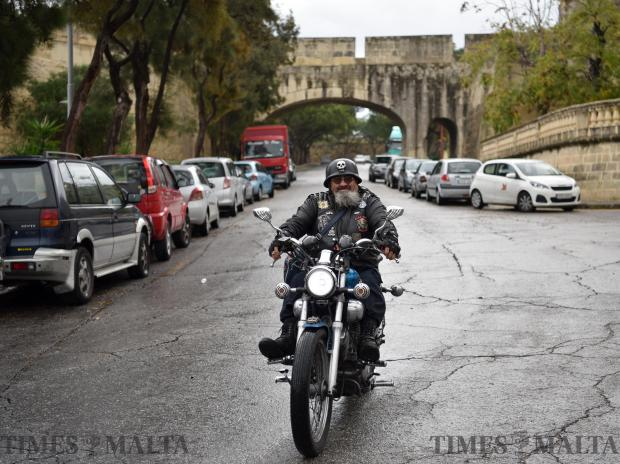 A man rides his motorbike on a slippery road in Cospicua on November 1. Photo: Mark Zammit Cordina