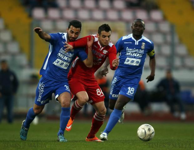 Balzan's Bojan Kaljevic (centre) battles his way through Pieta Hotspurs' Karl Micallef (left) and Orosco Anonam (right) during their Premier League football match at the National Stadium in Ta' Qali on April 6. Photo: Darrin Zammit Lupi