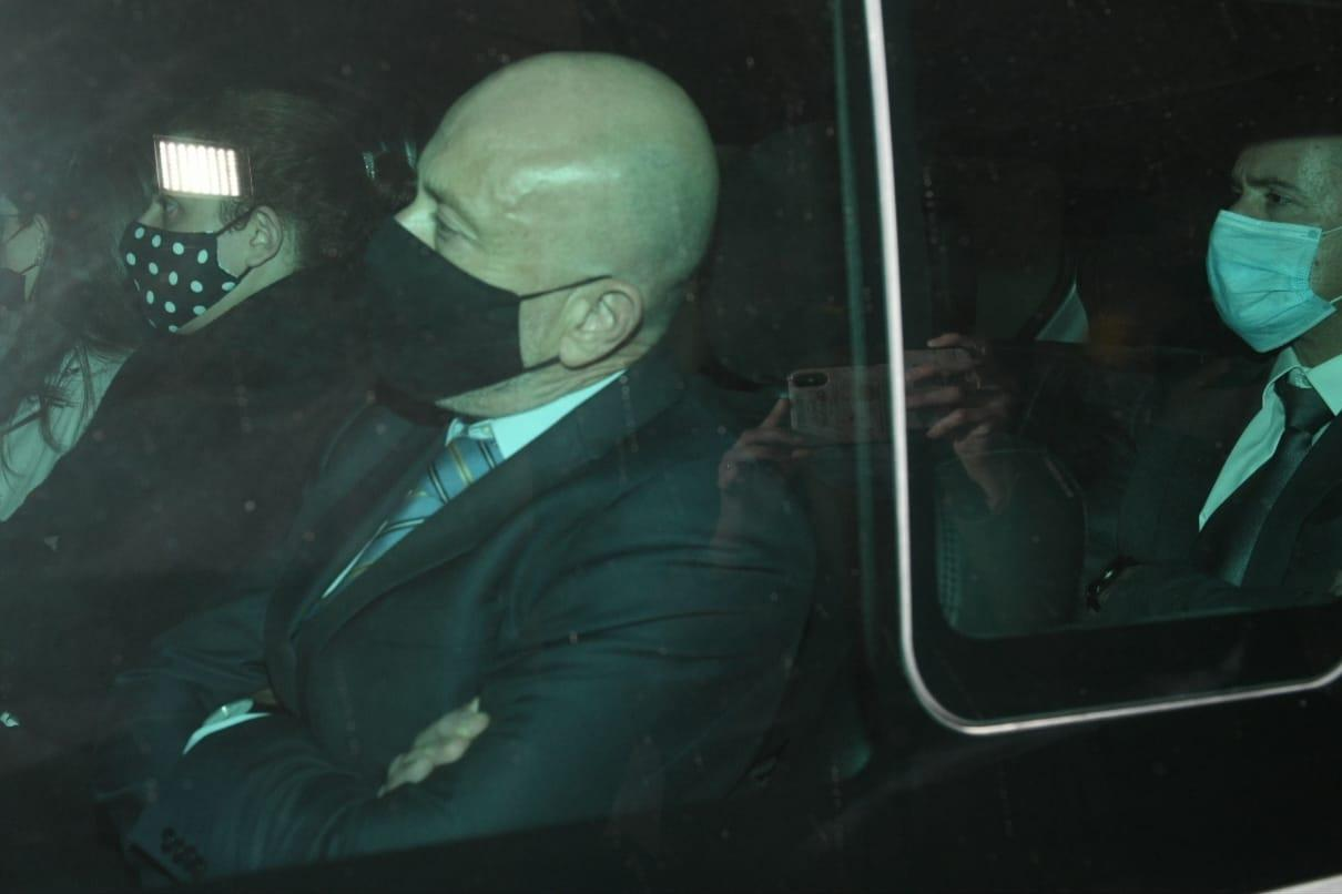 Brian Tonna, left, with Katrin Bondin Carter beside him and Karl Cini in the rear, being driven to Corradino Correctional Facility, after being charged with financial crime on Saturday.