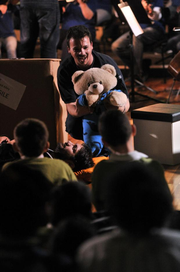 An actor holds a teddy bear during a performance of Haydn's Toy Symphony by the Malta Philharmonic Orchestra at the Robert Sammut Hall in Floriana on December 3. Photo: Jason Borg