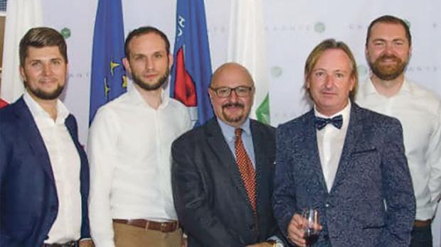 Exante staff celebrating their membership to the Malta Stock Exchange with MSE chairman Joseph Portelli.