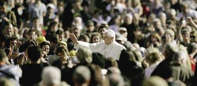 Pope Benedict XVI greets the faithful during his weekly general audience at St Peter`s square, yesterday.