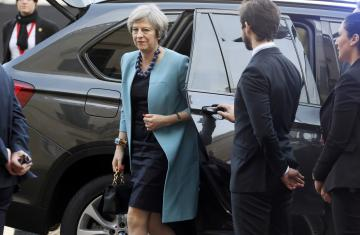 British Prime Minister Theresa May arrives for the summit.