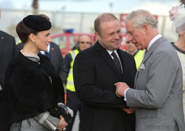 Prince Charles (right) is greeted by Prime Minister Joseph Muscat (centre) and his wife Michelle Muscat (left) on his arrival in Malta on November 26 for an official state visit. Photo: Matthew Mirabelli