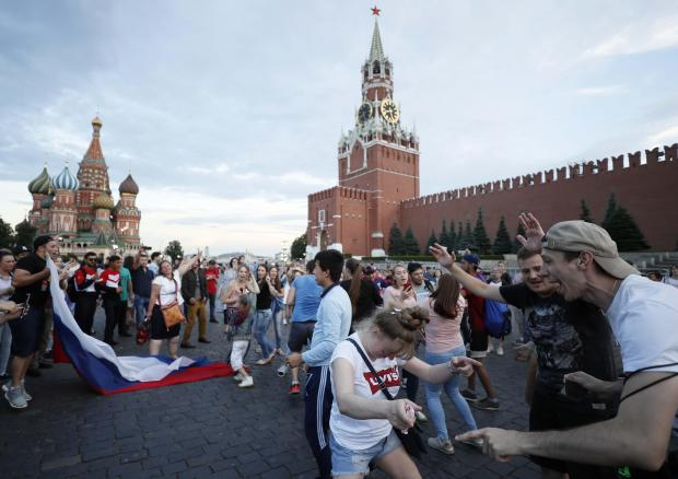Locals get the party started in Moscow following victory over Spain. Photo: Reuters