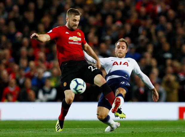 Man. United's Luke Shaw (left) is challenged by Christian Eriksen, of Tottenham.